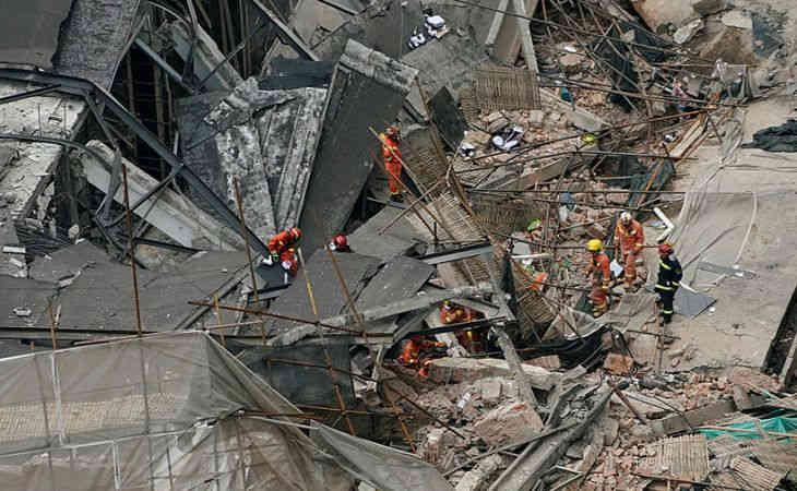 Трагедия в Шанхае увеличилось количество жертв рухнувшего здания